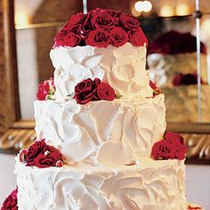 Buttercream Wedding Cake with Roses. Fresh roses topped the white chocolate buttercream wedding cake.