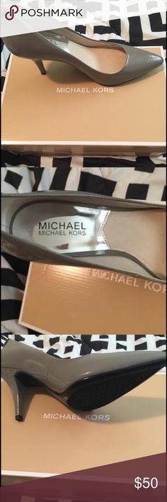 AUTHENTIC Michael Kors Pumps (BRAND NEW!!) Selling my size 71/2 Michael Kors Grey Pumps. NEVER WORN! Brand new! Michael Kors Shoes Heels