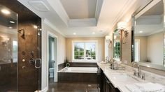 Master bath with soaking tub and shower with bench