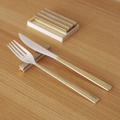 Brass cutlery set by Japanese designer Oji Masanori of Oji & Design. Featuring elegant, diamond-shaped handles and silver plated tips, the set is made in collaboration with metal workers at Futagami in Toyama-Takaoka City.