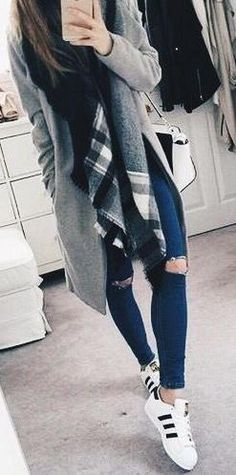 everyday street style. ripped denim. adidas. flannel scarf.