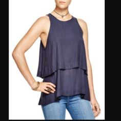 Free people layered top- NWT- size XS Free People top - NWT - size XS. Gently scooped keyhole in back adds skin-baring detail to a flowing tunic styled with a drapey tiered hem.  Color is beautiful midnight. Light weight, very comfortable, and stylish piece. Free People Tops