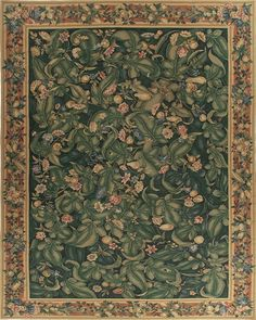 Julien Aubusson Rug 5035GD. Based on a Flemish wall tapestry made after 15th century voyages to the new world created a fascination for exotic botanicals. Oversize deep green leaves with gold and royal blue flowers on a midnight green backdrop. Shades of salmon highlight a fruit laden border. Made with ancient French Aubusson dyeing and weaving methods, this hand woven Aubusson flat weave rug has thousands of subtle color shades, similar to antique Aubusson rugs.