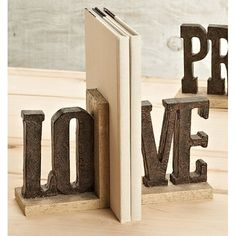 Features:  Product Type: -Decorative.  Style: -Contemporary.  Subject: -Words and text.  Theme: -Love/Family.  Color: -Brown.  Primary Material: -Resin.  Number of Bookends: -2. Dimensions:  Overall H