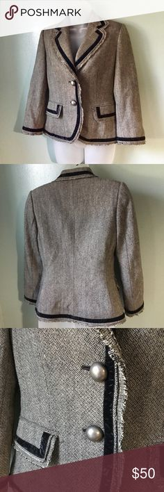 """Wool Banana Republic tweed blazer Adorable little riding jacket inspired blazer with velvet black trim edging on cuffs, pockets, and around lapel and beyond. Lovely tan tweed has a trendy ruff edge hem, two large brushed antiqued silver buttons on front, side pockets that are still sealed, slightly cropped sleeves and padding at shoulders . Worn once for a job interview and totally nailed it lol. Very young professional looking. Measured flat: 23"""" shoulder hem to bottom front hem  17""""…"""