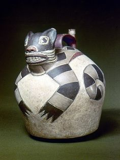 PERU: NAZCA WHISTLING JAR. Ceramic whistling water jar with a sculpted cat on the top, made by the Nazca civilization of ancient Peru, 1st to 8th century A.D.
