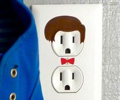 It's about <i>time</i> you added some character to your home's decor using the Doctor Who electrical outlet sticker. These removable vinyl matte decal anthropomorphizes your electrical outlets into tiny versions of our favorite Time Lord.