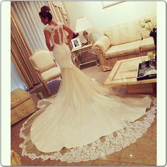 fitted trumpet style with lace and long train wedding dress - back