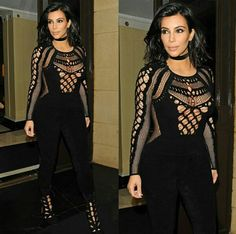 Kim kardashian west sexy black jumpsuit julien macdonals fall 15, and alaia cutout suede booties for the brit awards 15