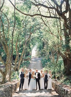 Elegant Outdoor Wedding- i love the drama of this shot with the path behind them!!!