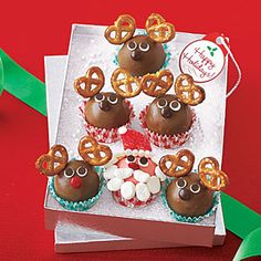 Santa and Reindeer Truffles Recipe - Start with store-bought truffles to make an easy, giftable Christmas treat for friends, family, or holiday visitors. Save one for Santa; we hear he likes truffles too, and certainly deserves one all to himself.  They also have a video on how to make these.  Very cute!
