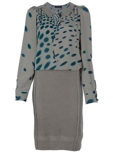 Green silk and wool blend dress from Sonia Rykiel featuring a green blouse top with contrast circular print, peter pan collar, rear pleating and long sleeves with buttoned cuffs. The grey wool skirt featured all-over ribbing and raised seam detailing.