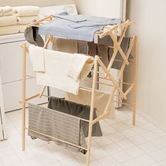 Large Wooden Drying Rack - I handwash so many of the delicate clothes that hang in my closet. Drying racks are so useful when you don't have a full load of laundry, or when you have to wash of an unexpected stain using the sink. With this drying rack you help conserve natural resources and reduce air pollution by air-drying your clothes. Made from unfinished pine. | found on gaiam.com | #greendorm