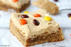 Peanut Butter Brownies - For the peanut butter lovers! Moist, cake-like peanut butter brownies topped with light and fluffy peanut butter frosting!