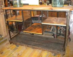 """Spectacular re-furbished industrial cart.  Perfect for a TV stand or a bar.   24""""w x 68""""l x 46.50""""t! $1695"""