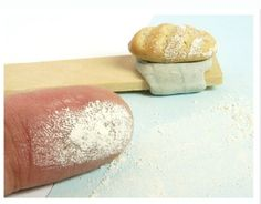 Creating a floured effect on bread - see  http://www.njdminiatures.com/wordpress/uploads/projects/CreatingFlouredEffect.pdf
