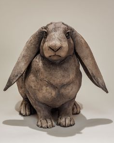 Rabbit sculpture in Raku fired ceramic, 40x25cm, by award winning artist Nick Mackman, available for immediate delivery worldwide.