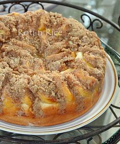 Peach Streusel Kuchen - a bread-like coffee cake with a fine and dense texture topped with fresh peaches and cinnamon almond streusel.   Roti n Rice