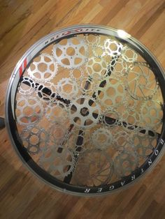 So fun! Recycled bike parts into an end table!