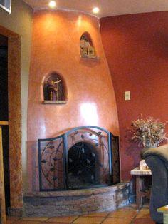 orange-brown kiva on white walls | kiva fireplaces | Pinterest ...