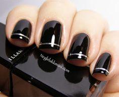 Black manicure. Silver nail art.