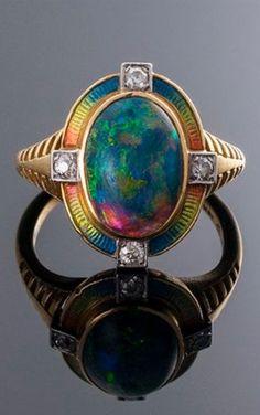An Art Nouveau 18k gold, enamel, black opal and diamond ring.