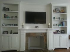 Painted Wall Unit With Fireplace Mantel by  Jencia Custom Cabinets & Mantels Inc.
