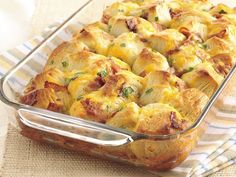 Bacon and cheese pull apart rolls. A great breakfast item when you have  company. Easy too! Reviews suggested adding addt'l egg, milk and butter to make it more moist.