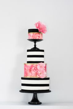 Love this modern trend- black & white stripes with floral patterns. Wedding cake by Cityview Bakehouse. Photography: Rachel Peters Photography - www.iamrachelpeters.com