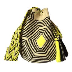 These double thread Wayuu mochila bags are all made in the region of La Guajira, Colombia by indigenous Wayuu women. Mochila bags are a very important handicraft that helps sustain the indigenous Wayuu people. These bags take approximately 10 days to make. The craft of crocheting is learnt at an early age and passed down from generation to generation. The mochilas are a reflection of the everyday shapes that surround the lives of the Wayuu tribe. Buy yours atwww.lombiaandco.com Tapestry Bag, Tapestry Crochet, Knit Crochet, Tribal Patterns, 10 Days, Handicraft, Bucket Bag, Knitwear, Reflection