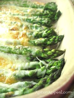 Apron Appeal: Asparagus Gratin...Oh this is so delicious...it makes a lot of sauce...I used less than half to mix my cheese in..and the recipe is very involved. In spite of how good it tastes I think I would rather roast the asparagus and then add the cheeses at the last minute.