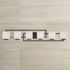 This six-light bathroom vanity wall light features sleek lines for a contemporary appeal. A great modern update your for stylish bath. This is an ADA compliant bath light. Lighting on the Square Wide Bronze Bath Vanity Light. Led Bathroom Lights, Bathroom Light Fixtures, Bathroom Vanity Lighting, Contemporary Bathroom Lighting, Modern Bathroom, Bathroom Ideas, Bathroom Tubs, Cozy Bathroom, Master Bathrooms
