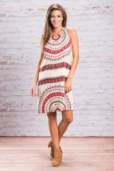 You won't mind the rain at all when you are wearing this dress! Who cares about rain when you look this great! The pattern is gorgeous and those colors are perfect for fall! You are going to love it simple shift fit too! This dress is fully lined and has a fabulous length! You are going to love rocking this beauty with your favorite booties!