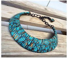 We bring you more undulating waves, finishing this week's ocean theme, in this collar necklace by Mara Devescovi. This jewelry piece is made of polymer clay using Stroppel canes, which is a fun surprise since they usually jump with a pop of graphic color. You can check out more of Mara's work on Flickr, she goes by Dev'Art60. Also, pop by The Polymer Arts magazine blog for more info on the upcoming Fall issue, http://www.thepolymerarts.com/blog/10862