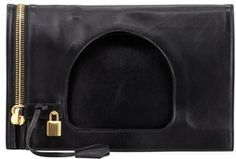 """Tom Ford Alix Small Padlock & Zip Shoulder Bag, Black on shopstyle.com   Black ramskin leather with Tom Ford signature yellow golden hardware. Fold-over open top with cutout shoulder strap. Functional zip down side with padlock and hanging key charm. Removable zip pouch. Alcantara® lining. 19""""H x 14""""W x 1/2""""D; weighs 1lb. 3oz. Made in Italy."""