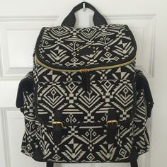 Carter's Aztec Backpack Diaper Bag Like new, packed and used once. Includes change pad (tags were removed, but never used) and clear attached mess pouch. Has built in stroller clips, adjustable backpack straps, grab handle and TONS of interior room with pockets inside and out. Very comfortable to wear. Zip top makes for easy access. Bags Baby Bags