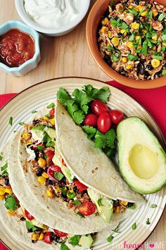 Slow Cooker Chicken and Black Bean Tacos ~ let your crock pot do all of the work on your next taco night! | FiveHeartHome.com