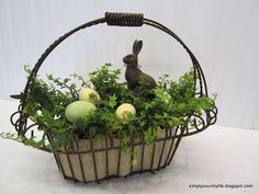 Rustic, Neutral Faux Chocolate Bunny Easter Centrepiece -  when I saw this craft project idea on Hometalk my first thought was :  the metal basket & a bunny make it perfect for French country decorating ---