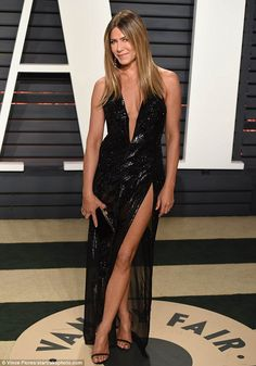 Jennifer Aniston - 2017 Oscars - Fierce after 45! The black glittery gown was a vampy look for the 48-year-old Valley Girl, who showcased her perky assets and muscular thighs