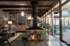 """The """"desert rubble concrete"""" adds a nice texture to this space.  Salt-Lake-Mid-Century-Modern-Home-13"""