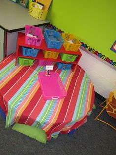Painted shoe shelf with baskets. Good idea for a writing center or word work center.