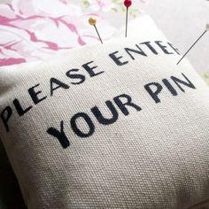 'PIN' cushion