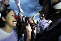 Demonstrators shout as they protest against the Confederation's Cup and the government of Brazil's President Dilma Rousseff in Brasilia on June 17.