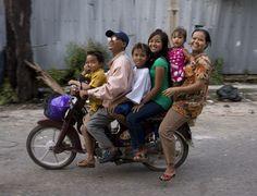 A family travels via a motorbike in Phnom Penh, Cambodia