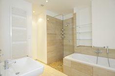 Spa Inspired Bathroom With Tiled Shower Floor And Glass Door