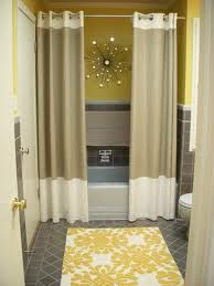Two shower curtains. Changes the whole feel of a bathroom. I love this idea!