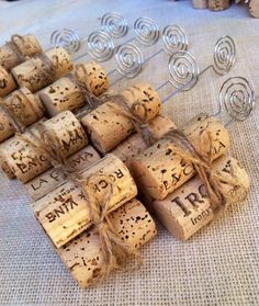These custom twine & wine cork Table Number Holders were commissioned by a bride getting married at a winery with a rustic vineyard theme. Discover your custom set of wedding Place Card Holders or table décor today at www.karasvineyardweddingshop.com