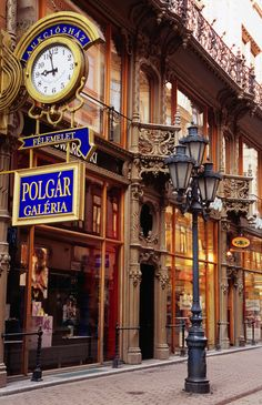 Shopfronts on Vaci utca, Váci utca is one of the main pedestrian thoroughfares and perhaps the most famous street of central Budapest, Hungary. It features a large number of restaurants and shops catering primarily to the tourist market. Places Around The World, Travel Around The World, Around The Worlds, Wonderful Places, Beautiful Places, Capital Of Hungary, Budapest Travel, Budapest Nightlife, Hungary Travel