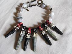 Hand made glass faces & resin beads. www.sallybass.com
