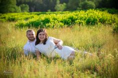 A couple lying in tall grasses. Copyright Photographics Solution 2013
